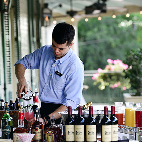 Bartender mixes drinks at a special event on the upstairs balcony