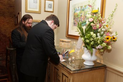 Guests Signing Guest Book