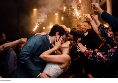 Bride & Groom share a kiss during their sparkler exit