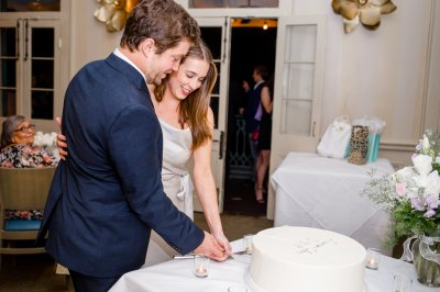 Couple celebrating their engagement with a cake.
