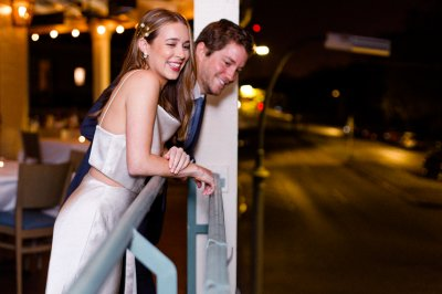Couple on the balcony at their engagement party.