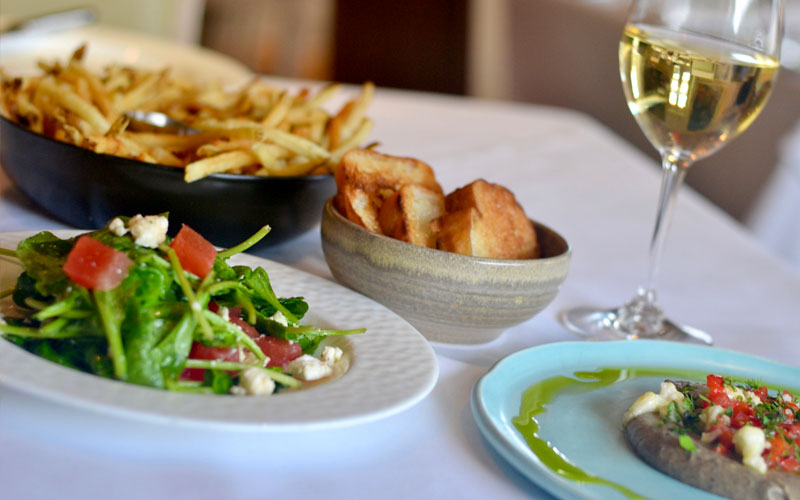 3 apps + glass of wine $33