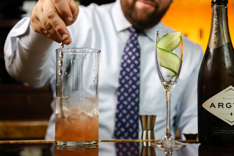 Bartender serving cocktail during happy hour